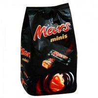 Order packing of chocolate bars ''Mars'' in the company of the flowers delivery